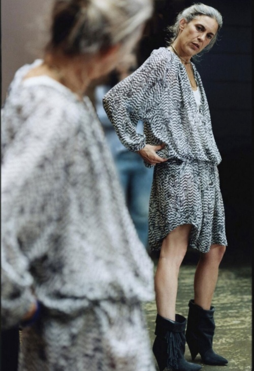 The designer Isabel Marant wearing her own tassel boot design for H&M. (photo - H&M)