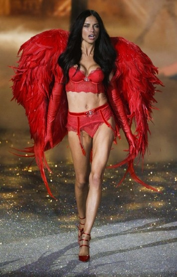 Brazilian model, Adriana Lima wearing red for this year's catwalk show. (photo - Reuters)