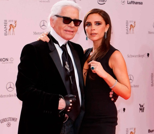 Victoria posed with Karl Lagerfeld for a photoshoot for French Elle at legendary designer Coco Chanel's home. Here she appears with Karl at Mercedes Bench Fashion week.