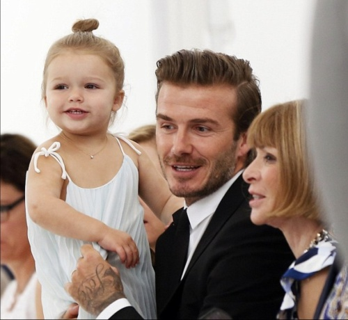 Former footballer, husband David with daughter Harper and American Vogue editor-in-chief, Anna Wintour at Mercedes-Benz Fashion Week  in New York September 2013.