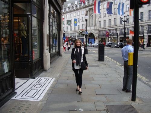 Striding down Regent Street, London. (photo - worklondonstyle)