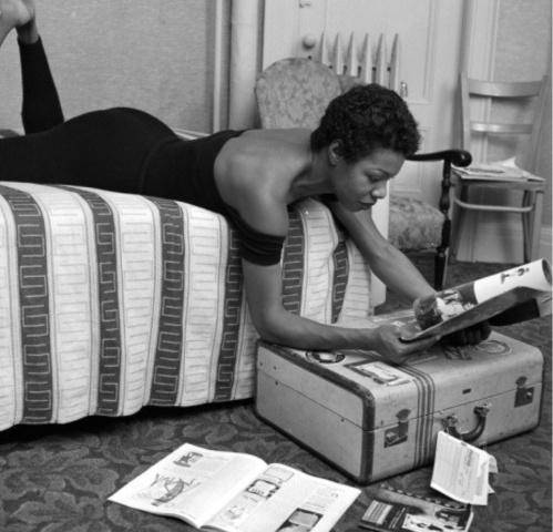 Maya Angelou reading in her dressing room before a performance at  Village Vanguard in New York City.(photo- G. Marshall Wilson)